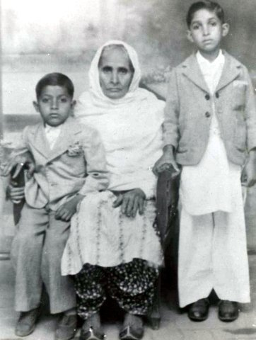 MY GRANDMOTHER with me and my cousin Asraf