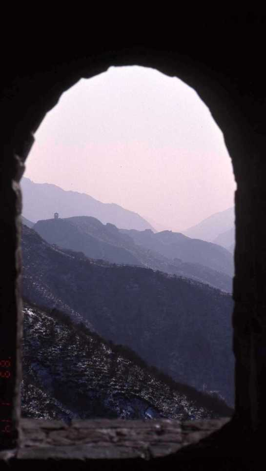 LOOKING OVER THE MOUNTAINS FROM GREAT WALL OF CHINA